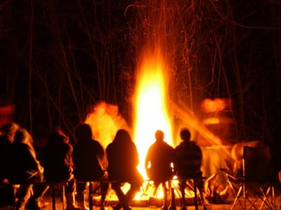 © Zedster   Dreamstime.com - Fire With People Sitting Around Photo